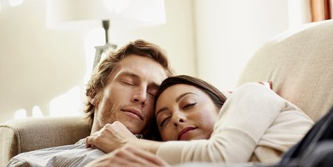 Loving couple sleeping on sofa