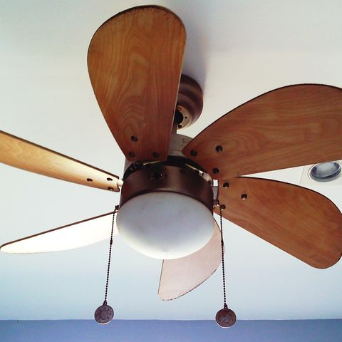 low angle view of brown ceiling fan