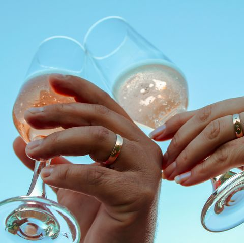 low angle view of couple toasting champagne flutes