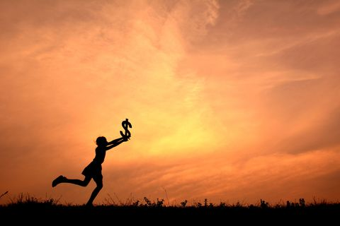 Low Angle View Of Silhouette Woman Jumping In Sky