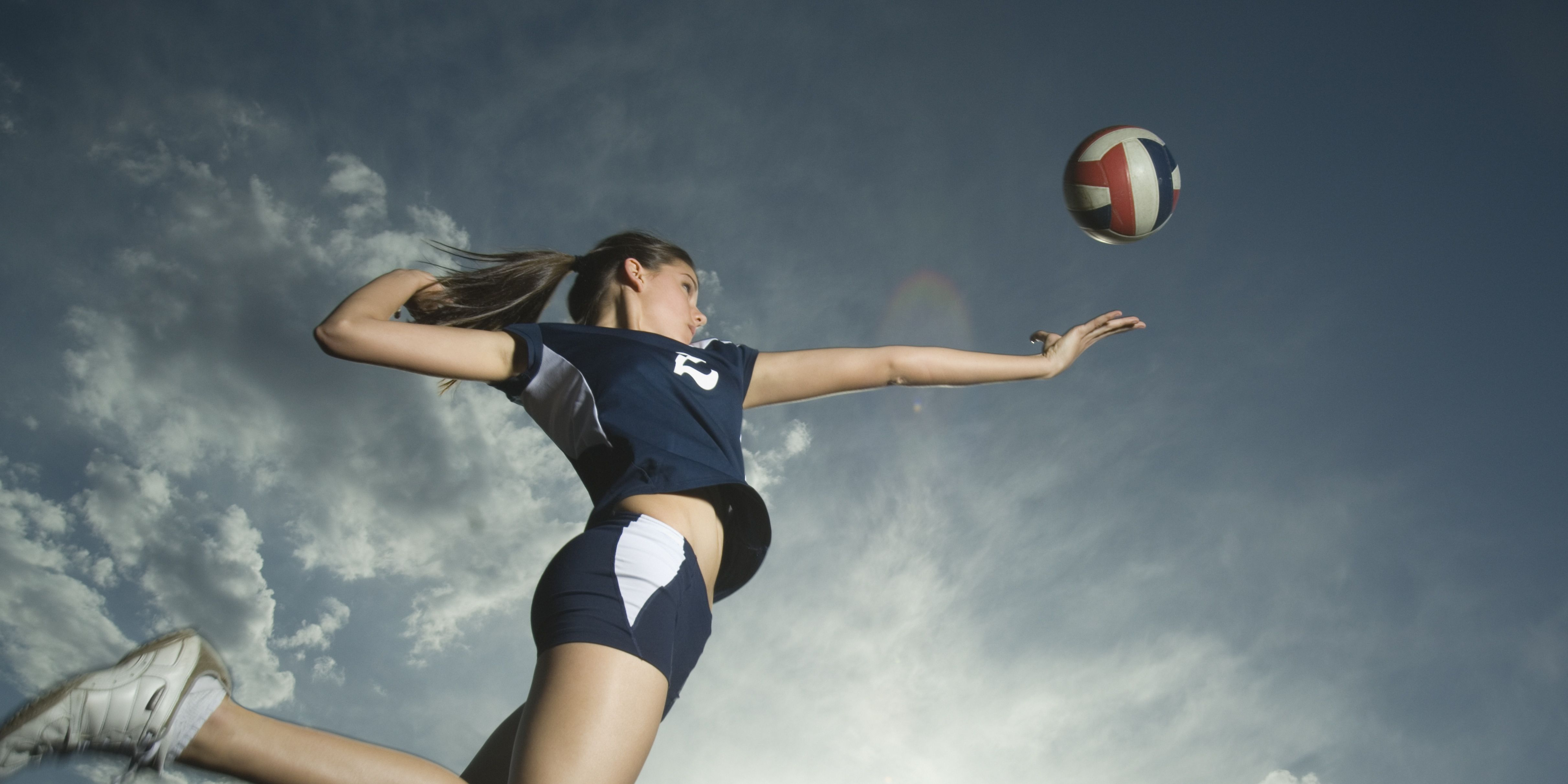Low angle view of volleyball player jumping