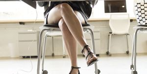 Low section of businesswoman working at desk