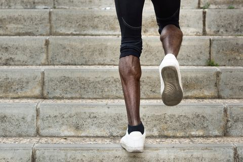 Low Section Of Man Moving Up On Steps