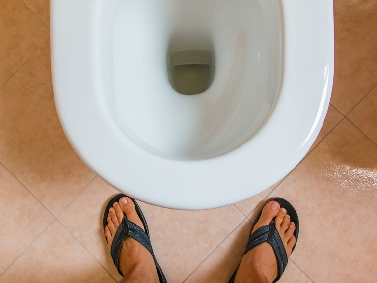 Here's How Much Mess You Make When You Pee Standing Up, According to UV Lights