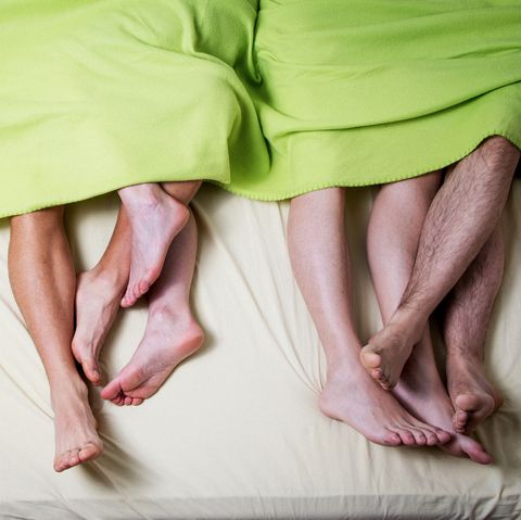 Low Section Of People In Bed