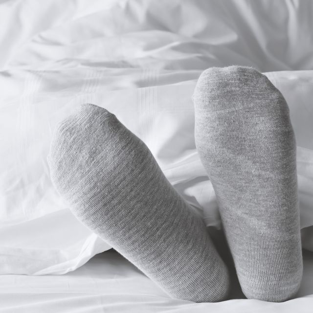 this is why you should wear socks to bed, according to a doctor