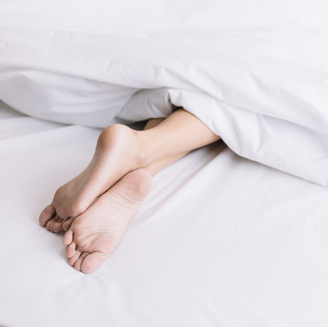person sleeping on bed