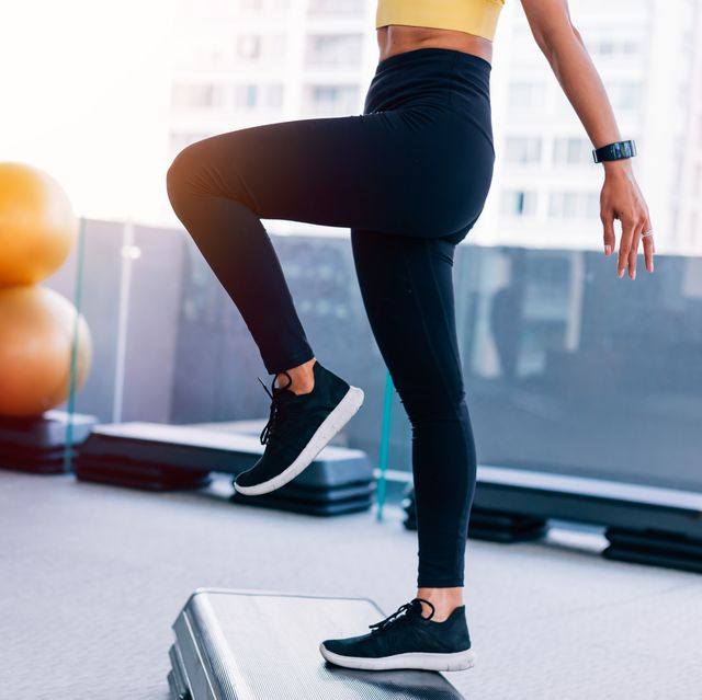 low section of woman exercising at gym