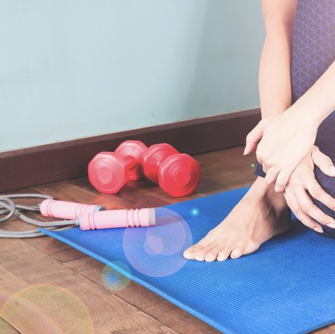 Low Section Of Woman Exercising At Home