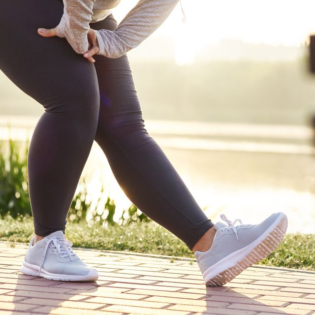 Low section of woman stretching her legs