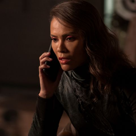 lesley ann brandt as maze, seen in a black top while holding a phone to her ear, in lucifer season 5