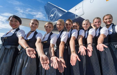 Team, Social group, Uniform, Flight attendant, Crew, School uniform, Event, Smile,