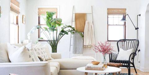 Living room, Room, Furniture, Interior design, Floor, Wood flooring, Blue, Property, Table, Home,