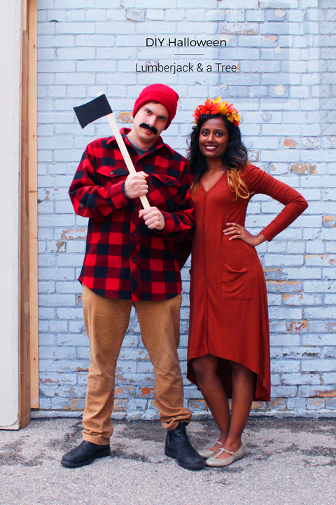 a couple dressed as a lumber jack and a tree