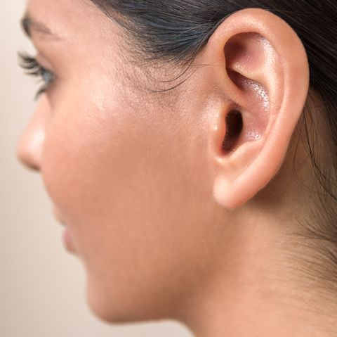 lump behind the ear causes and treatment