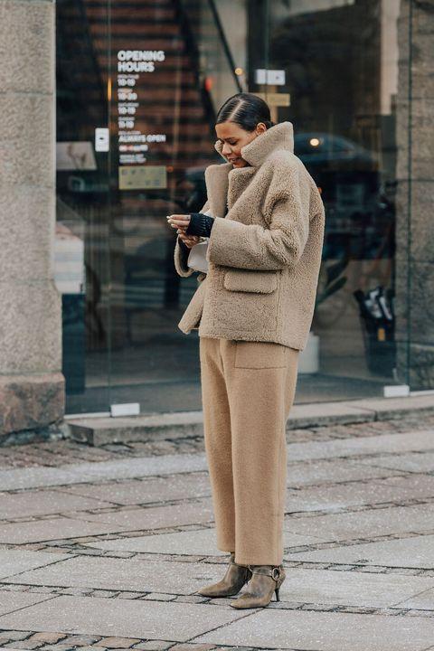 Photograph, Street fashion, Snapshot, Standing, Fashion, Street, Human, Coat, Headgear, Leg,