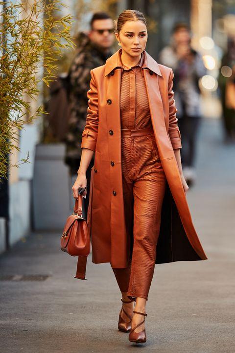 Fashion, Street fashion, Clothing, Fashion model, Orange, Coat, Runway, Overcoat, Brown, Outerwear,