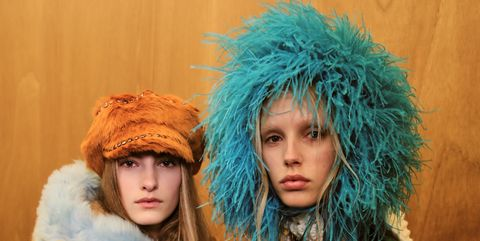Textile, Fur clothing, Natural material, Headgear, Teal, Costume accessory, Turquoise, Animal product, Fashion, Fur,