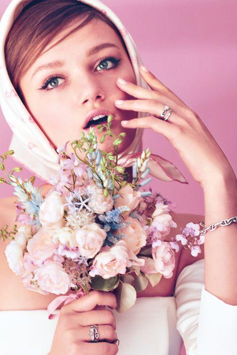 Skin, Pink, Beauty, Photo shoot, Flower, Lip, Hand, Peach, Model, Nail,