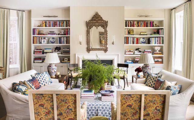 living room, built in bookshelves, indoor plants, white sofa