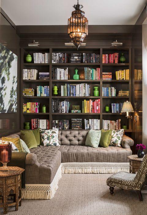 bookcase, brown sofa bed, bookcase, library books