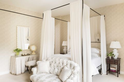 white bedroom, white sheets, white curtains, black bed frame,