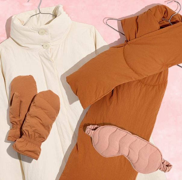 white coat, pink eye mask, and rust colored scarf and mittens with pink, textured background