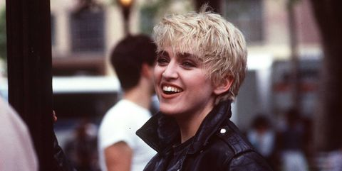 Hair, Photograph, Facial expression, People, Blond, Jacket, Smile, Leather jacket, Leather, Cool,