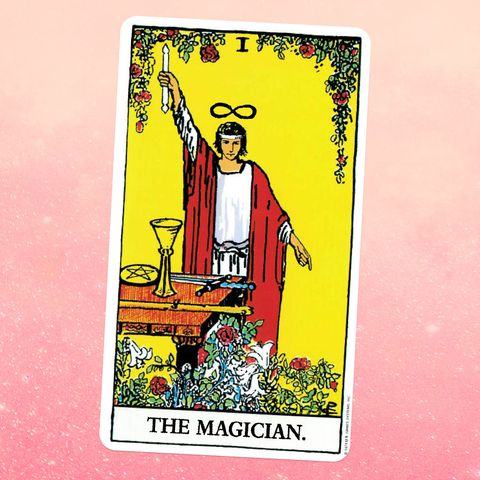the tarot card the magician, showing an androgynous white figure in a white tunic and red robe with an infinity symbol over their head like a halo, holding up a wand on a tale in front of them lies a goblet, a coin, a sword, and a wooden staff they're surrounded by flowers