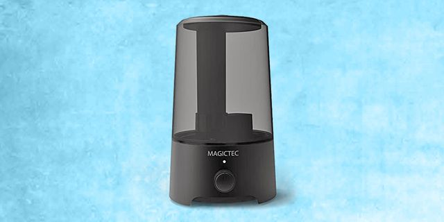 black magictec cool mist humidifier with light blue, textured background