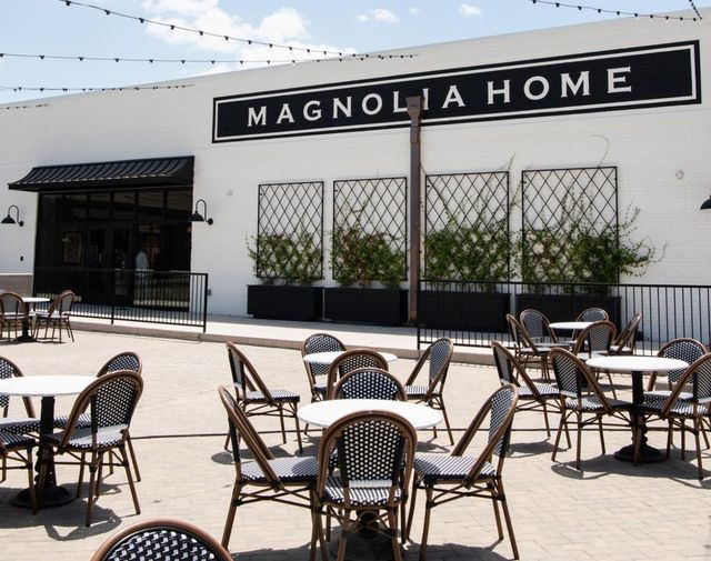 magnolia home exterior with seating in front of it