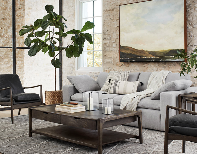 new magnolia furniture collection  displayed in a room with a brick wall