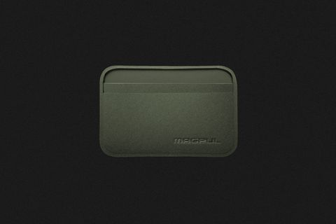 a thin green wallet on a black background