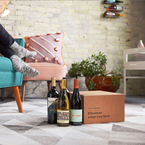 Bright Cellars wines by a box on the floor