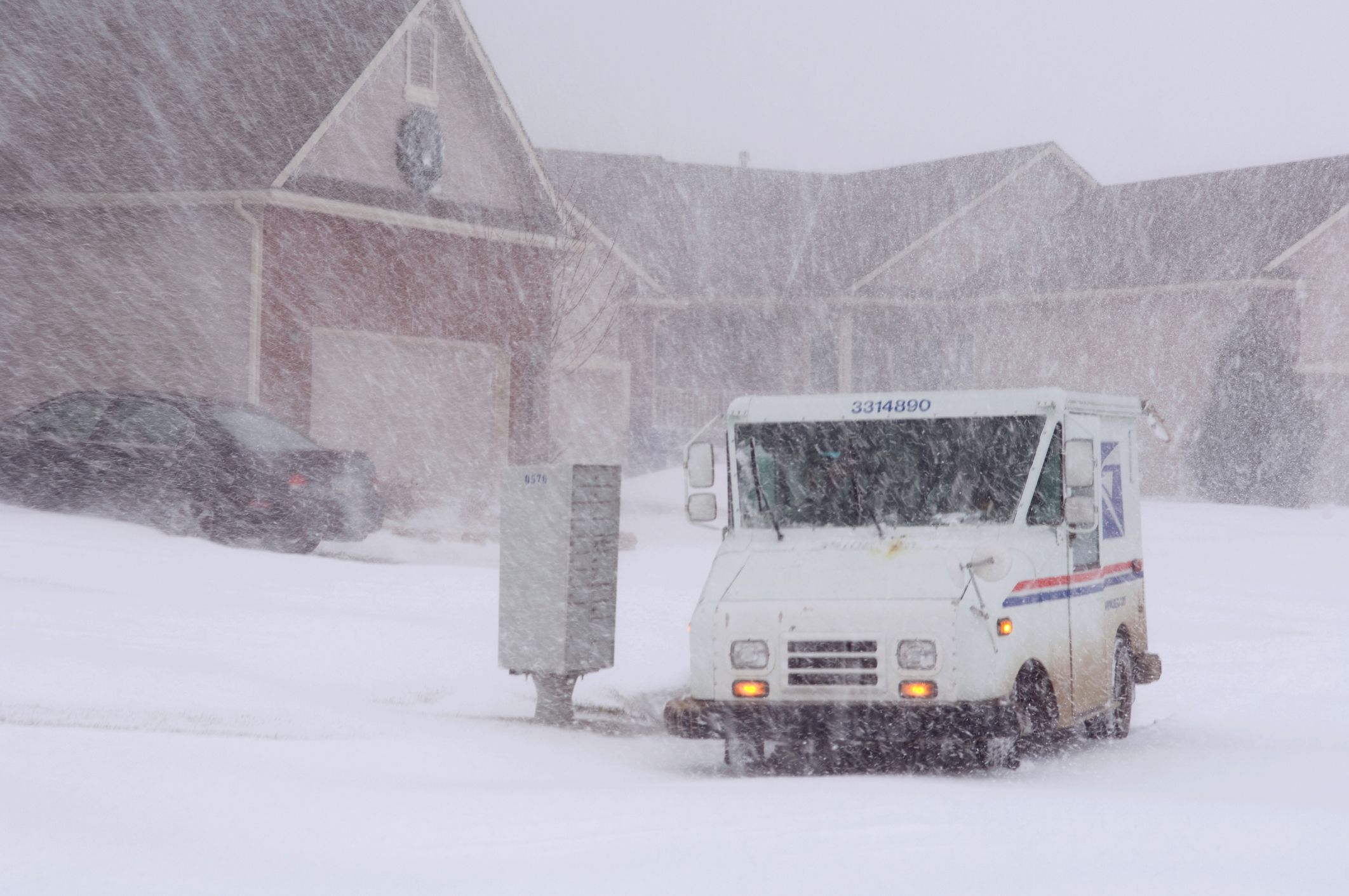 A U.S. Mail truck navigates a residential street during blizzard conditions in Wichita, Kansas on December 22, 2007.