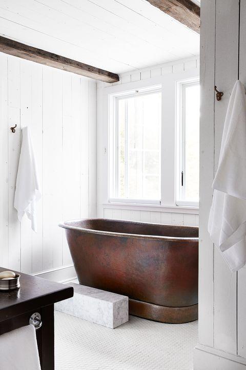 white bathroom with copper tub