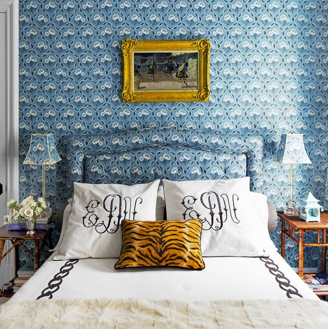 blue bedroom with tiger print pillow