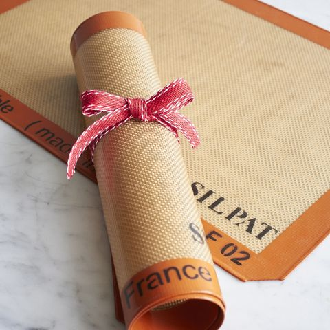 Orange, Gift wrapping, Twine, Present, Yoga mat, Material property, Peach, Paper, Tableware,