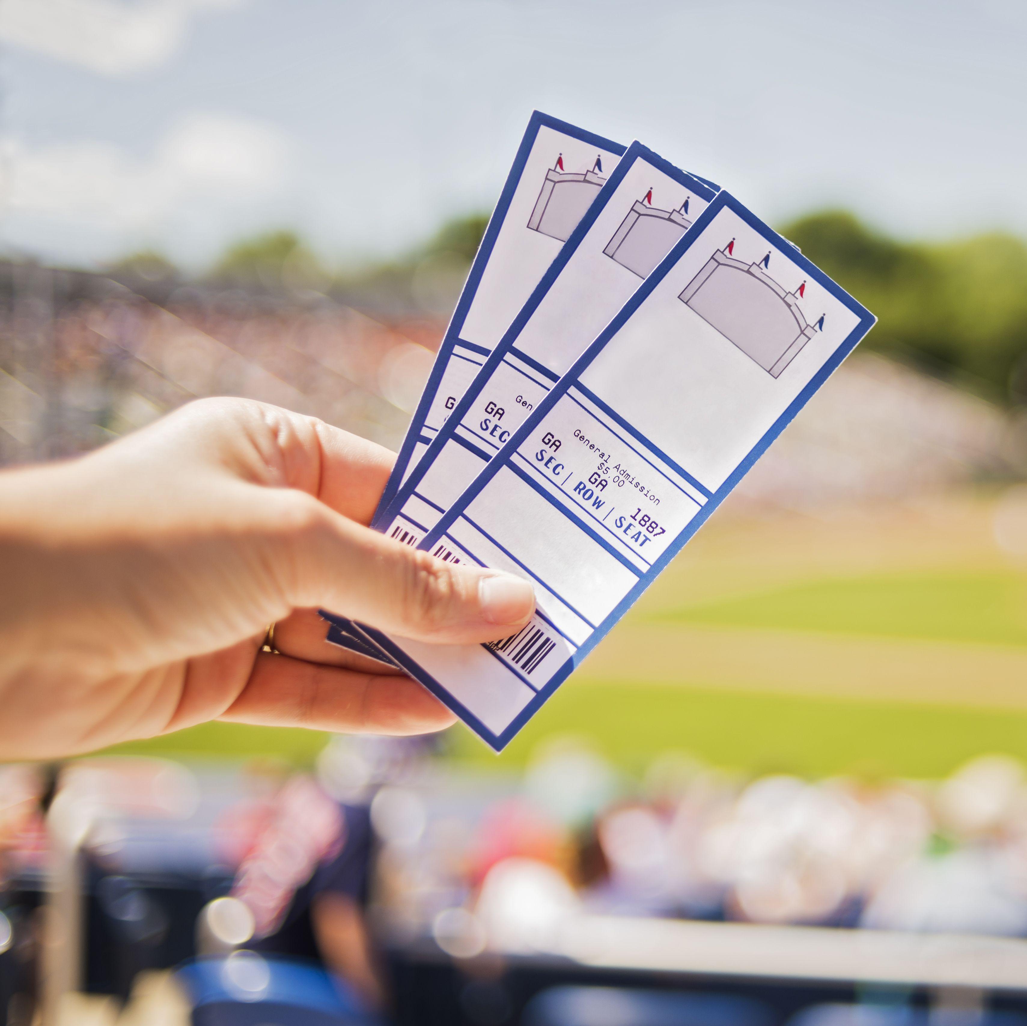 USA, Maine, Portland, Close-up of hand holding tickets at stadium