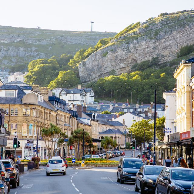 mainstreet in llandudno town with great orme head cliff in the background