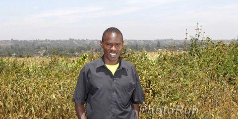 Patrick Makau standing in a field in Kenya