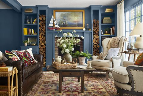 deep blue living room with fireplace and builtin bookcases