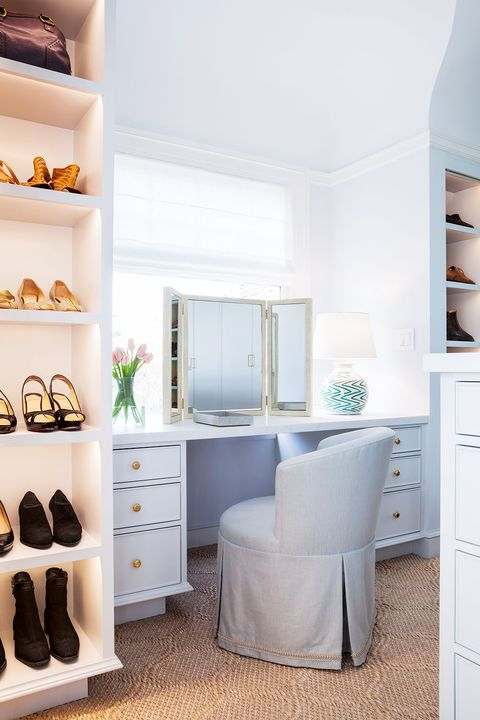 light blue traditional vanity table in walk in closet