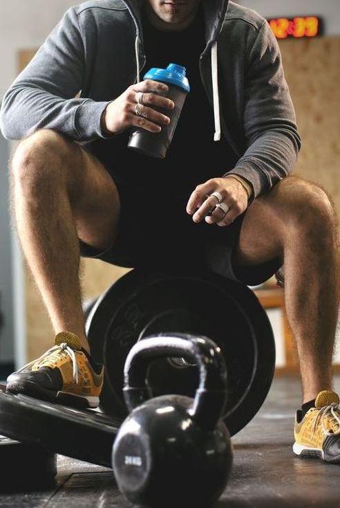 male athlete enjoys delicious health drink