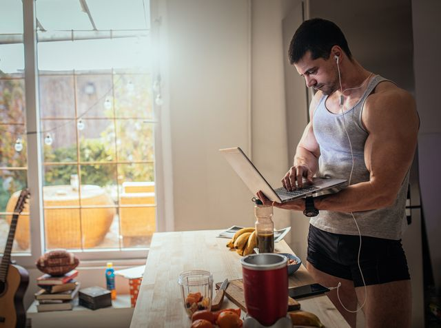 male athlete in the kitchen