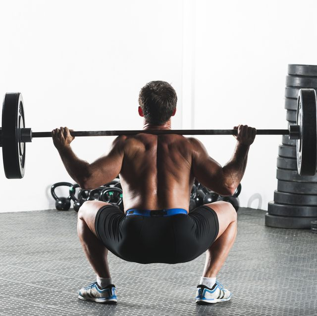 male doing weights during gym