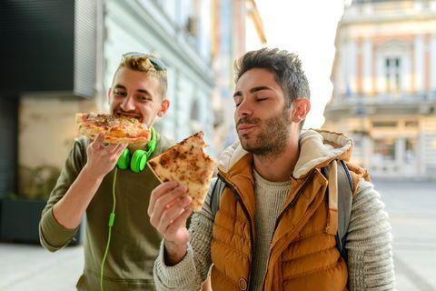 Male Friends Having Pizza