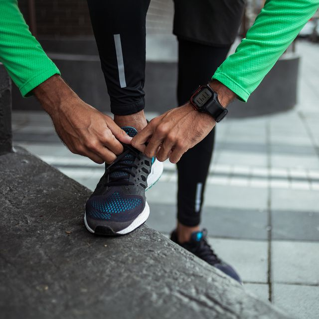 male jogger tying his shoe