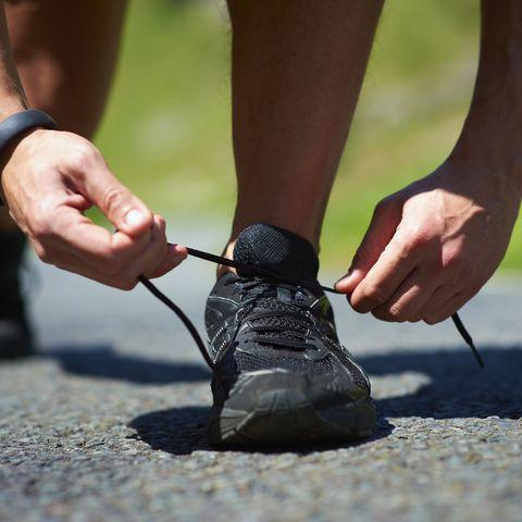 Male Runner Tying Shoe Lace