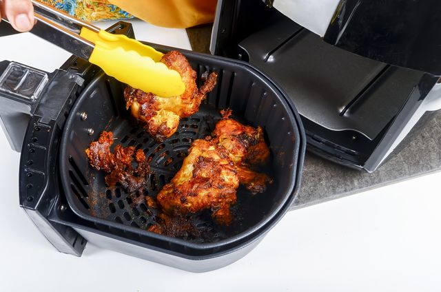 fried chicken cooking in an air fryer